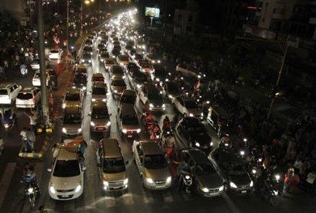 1063406487-vehicles-stand-in-traffic-jam-as-indian-fans-celebrate-past