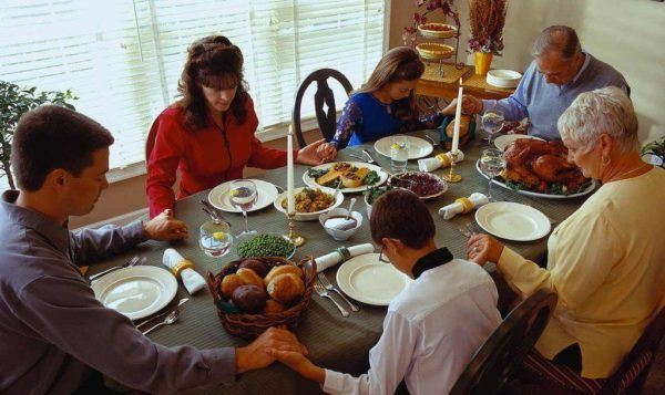 Family Praying Before Dinner ca. 2001